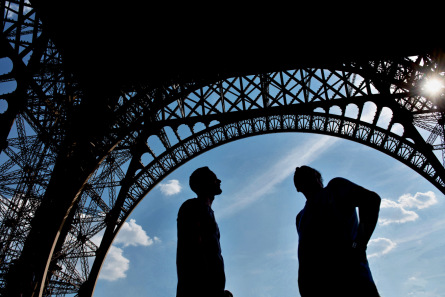 Silhouettes under the Eiffel Tower